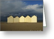 Shoreline Greeting Cards - Beach huts under a stormy sky in Normandy Greeting Card by Bernard Jaubert
