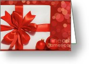 Merry Photo Greeting Cards - Big red bow on gift  Greeting Card by Sandra Cunningham