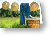 Clothesline Greeting Cards - Blue jeans and straw hats on clothesline Greeting Card by Sandra Cunningham