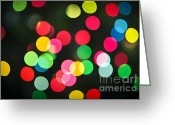 Festive Greeting Cards - Blurred Christmas lights Greeting Card by Elena Elisseeva