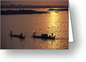 River Scenes Greeting Cards - Boats Silhouetted On The Mekong River Greeting Card by Steve Raymer