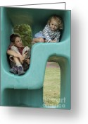 12-13 Years Greeting Cards - Boy and girl playing in plastic cube Greeting Card by Sami Sarkis