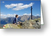Kid Photo Greeting Cards - Boy on mountain top looking at cross Greeting Card by Matthias Hauser