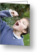 Pretending Greeting Cards - Boy Pretending To Eat An Earthworm Greeting Card by Ian Boddy