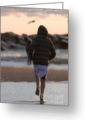 Lake Low Country Greeting Cards - Boy running on beach near surf Greeting Card by Purcell Pictures