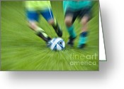 Kicking Football Greeting Cards - Boys Soccer Greeting Card by John Greim