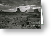 John Wayne Greeting Cards - Breaking Light at Monument Valley - Black and White Greeting Card by Brian Stamm