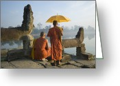18-19 Years Greeting Cards - Buddhist Monks Standing Next To Stone Carvings Greeting Card by Martin Puddy