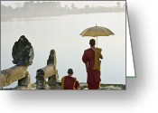 18-19 Years Greeting Cards - Buddhist Monks Standing On Waters Edge Greeting Card by Martin Puddy