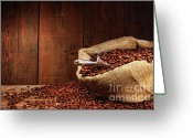 Coffee Beans Greeting Cards - Burlap sack of coffee beans against dark wood Greeting Card by Sandra Cunningham