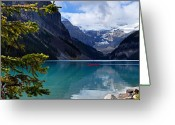 Canadian Rockies Greeting Cards - Canoe on Lake Louise Greeting Card by Larry Ricker