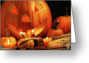 Pumpkin Farm Greeting Cards - Carved pumpkin with candles Greeting Card by Sandra Cunningham