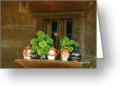 Wooden Bowls Greeting Cards - Ceramic jugs and geraniums at the window Greeting Card by Emanuel Tanjala