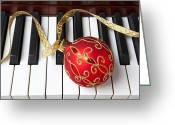 Pianos Greeting Cards - Christmas ornament on piano keys Greeting Card by Garry Gay