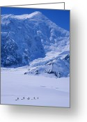 Five People Greeting Cards - Climbing Expedition Passes Below Mount Greeting Card by Bill Hatcher