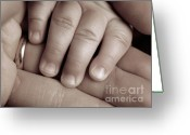 Babys Greeting Cards - Closeup of a Babys Hand Greeting Card by Oleksiy Maksymenko