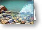 Shoreline Greeting Cards - Closeup of rocks in water at lake Louise Greeting Card by Sandra Cunningham