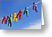 Clothesline Greeting Cards - Colorful clothes pins Greeting Card by Elena Elisseeva