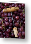 Food And Beverage Greeting Cards - Corkscrew and wine cork on red grapes Greeting Card by Garry Gay