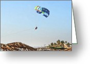 Drifter Greeting Cards - Couple parasailing over shacks Goa Greeting Card by Kantilal Patel
