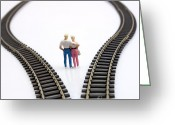 Choice Greeting Cards - Couple two figurines between two tracks leading into different directions symbolic image for making decisions Greeting Card by Bernard Jaubert