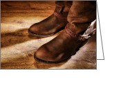 Spurs Greeting Cards - Cowboy Boots on Saloon Floor Greeting Card by Olivier Le Queinec