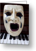 Pianos Greeting Cards - Crying mask on piano keys Greeting Card by Garry Gay
