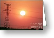 Silhouettes Greeting Cards - Electrical pylon at silhouetted at sunset Greeting Card by Sami Sarkis