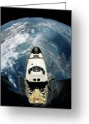Space.planet Greeting Cards - Elevated View Of A Spacecraft Orbiting Over The Earth Greeting Card by Stockbyte