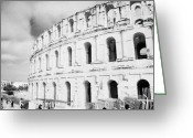 African Heritage Photo Greeting Cards - Entrance and front of the the old roman colloseum against blue cloudy sky el jem tunisia Greeting Card by Joe Fox