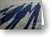 Mother Of Four Greeting Cards - Family of four casting shadows on cobbled stone street Greeting Card by Sami Sarkis