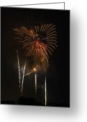 Explosives Greeting Cards - Fireworks Explode Over The City In An Greeting Card by Wolcott Henry