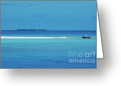 Tropical Climate Greeting Cards - Fishing boat anchored on a white sand beach with a tropical island in the background in Maldives Greeting Card by Sami Sarkis