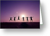 Full-length Greeting Cards - Friends Jumping Against Sunset Greeting Card by Kazi Sudipto photography