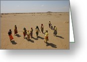 Desolate Landscapes Greeting Cards - Gabra Women Carrying Heavy Jerry Cans Greeting Card by Lynn Johnson