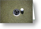 Golf Green Greeting Cards - Golf Ball Next to a Putting Cup Greeting Card by Jetta Productions, Inc