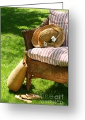 Seated Greeting Cards - Grass lawn with a wicker chair  Greeting Card by Sandra Cunningham