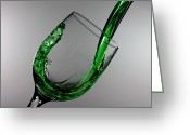 Pouring Greeting Cards - Green juice splashing from a wine glass Greeting Card by Mingqi Ge