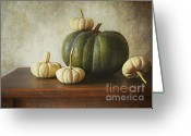 Pumpkin Farm Greeting Cards - Green pumpkin and gourds on table  Greeting Card by Sandra Cunningham
