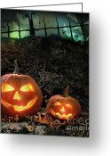 Laughing Greeting Cards - Halloween pumpkins on rocks  at night Greeting Card by Sandra Cunningham