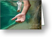 Falling Down Greeting Cards - Hand take a falling stone Greeting Card by Mats Silvan