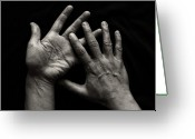 Human Hand Greeting Cards - Hands On Black Background Greeting Card by Luigi Masella