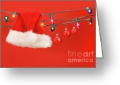 Shimmer Greeting Cards - Hanging lights with santa hat Greeting Card by Sandra Cunningham
