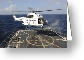 Piracy Greeting Cards - Helicopter Lands Aboard The Arleigh Greeting Card by Stocktrek Images