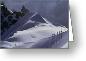 Hikers And Hiking Photo Greeting Cards - Hikers Follow Paths Across The Snow Greeting Card by Paul Chesley