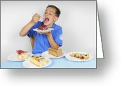 Hunger Greeting Cards - Hungry boy eating lot of cake Greeting Card by Matthias Hauser