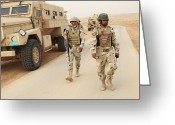 Iraqi Military Greeting Cards - Iraqi Army Soldiers Walk Beside An Mrap Greeting Card by Stocktrek Images