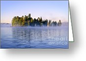 Misty Greeting Cards - Island in lake with morning fog Greeting Card by Elena Elisseeva