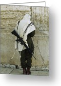 Headgear Greeting Cards - Israeli Soldier With Rifle Praying Greeting Card by Paul Chesley