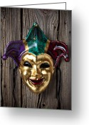 Masks Greeting Cards - Jester mask hanging on wooden wall Greeting Card by Garry Gay
